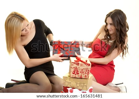 Two girls fighting over a gift - stock photo