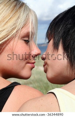 two girls flirting in the sun
