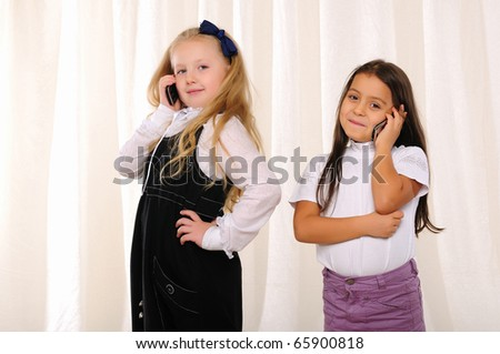 Two girls girlfriends chatting on the phone