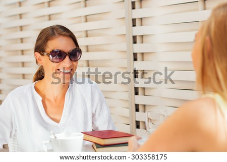 Two girls having a conversation