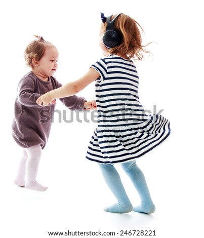 Two girls holding hands sisters dance in a circle.Isolated on white background - stock photo