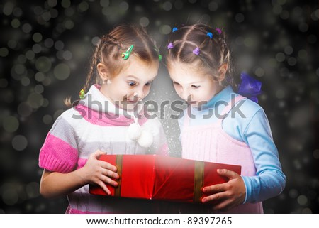 Two girls holding magic box - stock photo
