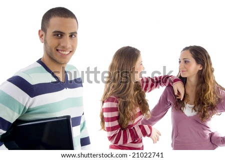two girls holding to each other and guy looking at camera against white background - stock photo
