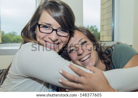 Two girls hug each other - stock photo
