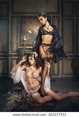 Two girls in bathrobe and lingerie - stock photo