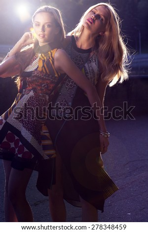 two girls in dresses in  summer in a wig - stock photo