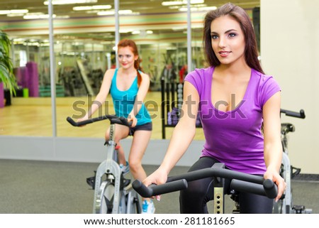 Two girls in fitness club - stock photo