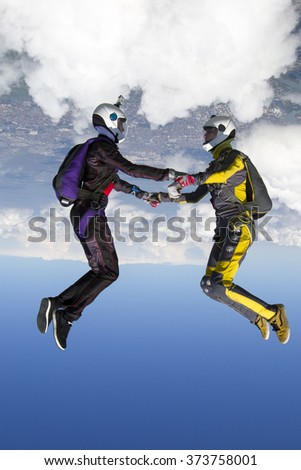 Two girls in free fall. - stock photo