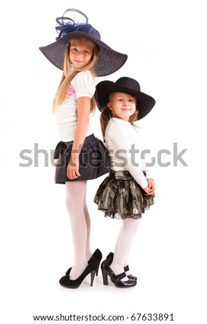two girls in hats