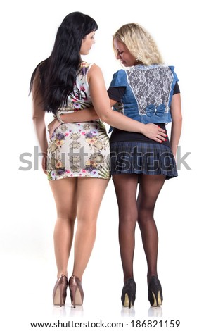 Two girls in pantyhose and mini skirt