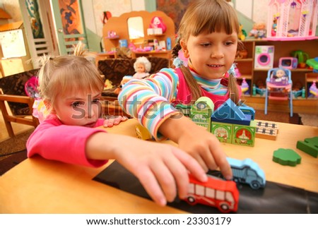 Two girls in playroom - stock photo
