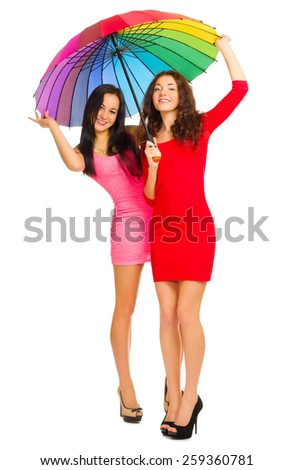 Two girls in red dresses with umbrella isolated - stock photo
