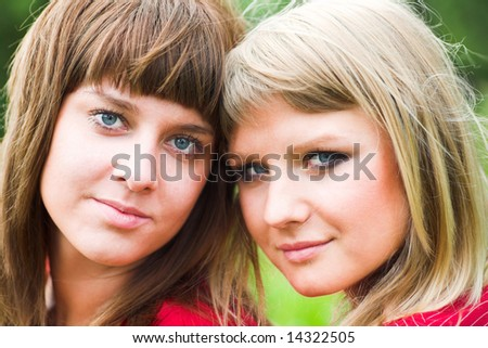 Two girls in red in park