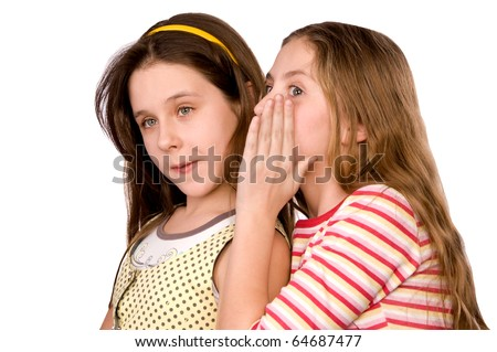 Two girls in the age of ten and eleven sharing news isolated on white
