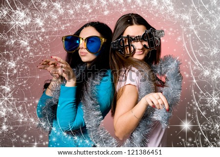 Two girls in the big fancy glasses.Background of stars - stock photo
