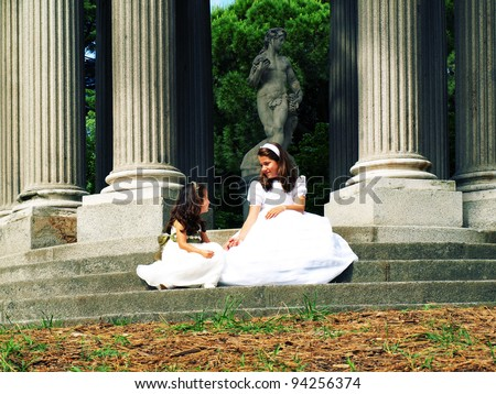 Two girls in the Communion Day - stock photo