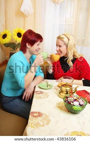 two girls in the kitchen - stock photo