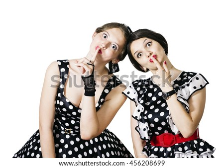 Two girls in the style of pin-up on a white background shows a gesture of silence