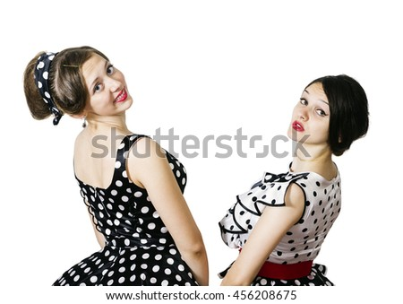 Two girls in the style of pin-up posing turning back - stock photo