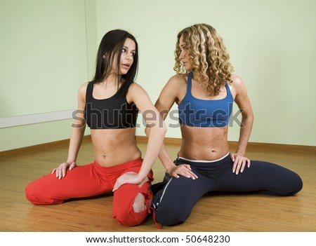 Two girls involved in fitness in the gym