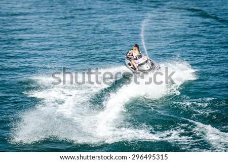 Two girls jetskiing - stock photo