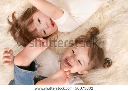 Two girls laughing - stock photo