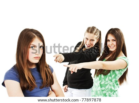 Two girls making fun of a girl. Isolated against a white background. - stock photo