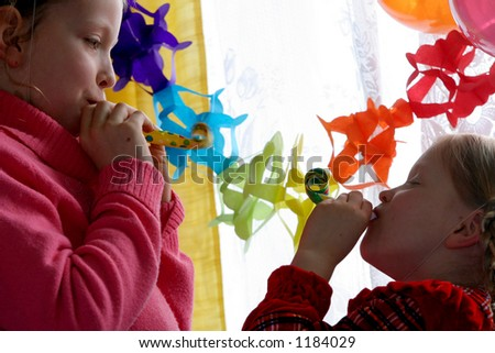 Two girls making noise - stock photo