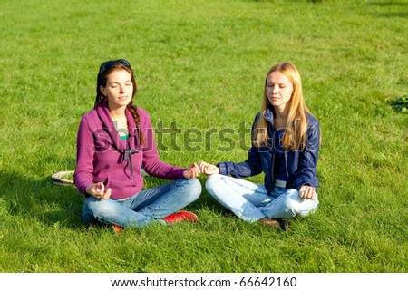 Two girls meditating
