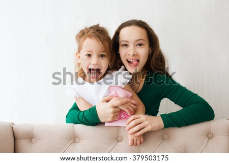 two girls of a chechtrenka have fun with the room - stock photo