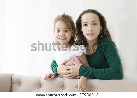 two girls of a fun have fun with the room - stock photo