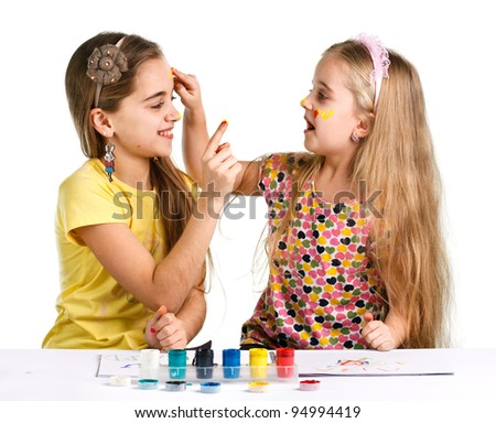 two girls painted with colorful paint