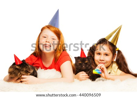 Two girls play party game with their cats