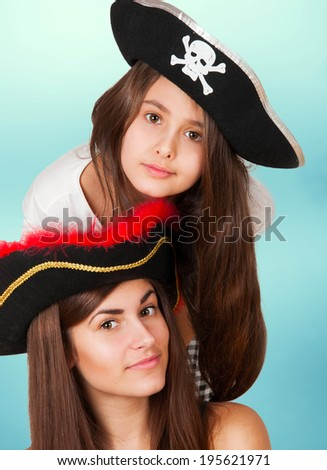 two girls playing pirates