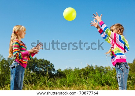 Two girls playing with the ball - stock photo