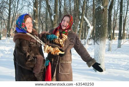 Two girls plays during Pancake Week at Russia - stock photo