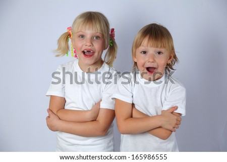 two girls posing and open their mouths - stock photo