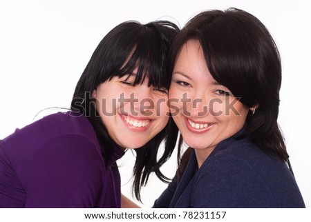 two girls posing on a white background