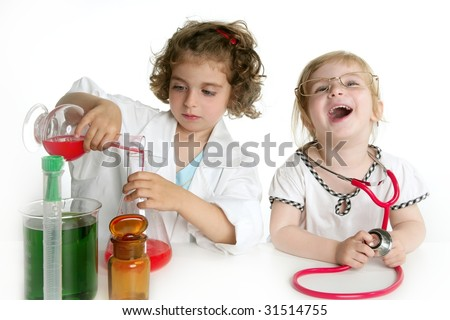 Two girls pretending to be doctor in the laboratory - stock photo