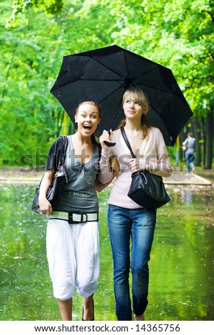 Two girls rejoice to rainy weather.