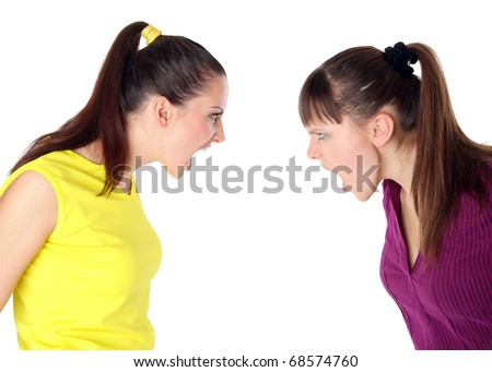 two girls shouting at each other. Isolated at white background - stock photo