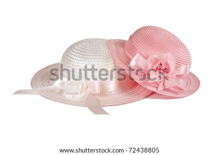 Two girls ( sisters) hats isolated on white for Easter or spring high key applications - stock photo