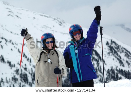 two girls skiing in the Alps - stock photo