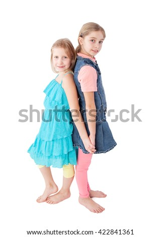 two girls standing back to back