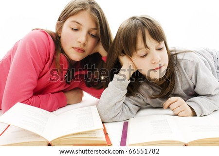 Two girls students studying on the floor