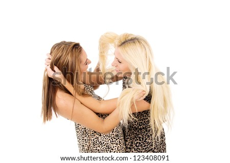 Two girls swear and fight - stock photo