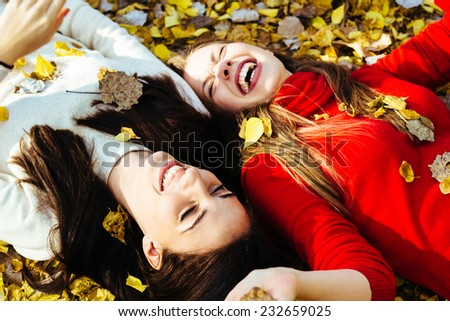 Two girls talking and laughing - stock photo