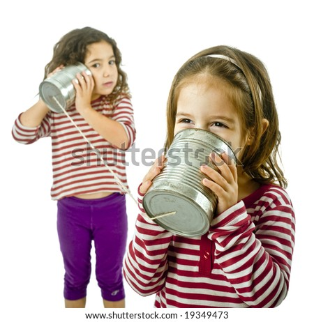 two girls talking on a tin phone isolated on white - stock photo