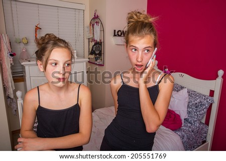 two girls talking on the phone - stock photo