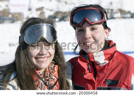 Two girls teens in sport clothes winter outdoors